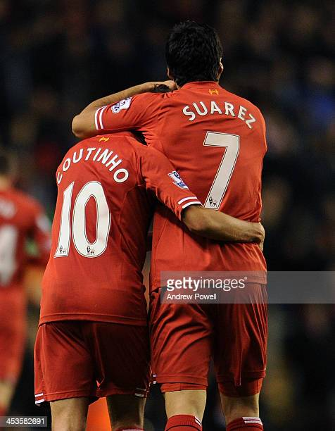 Luis Suarez and Philippe Coutinho of Liverpool celebrate the fourth goal of Luis Suarez during the Barclays Premier League match between Liverpool...