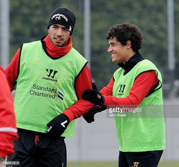 Luis Suarez and Philippe Coutinho of Liverpool in action during a training session at Melwood Training Ground on April 11 2013 in Liverpool England
