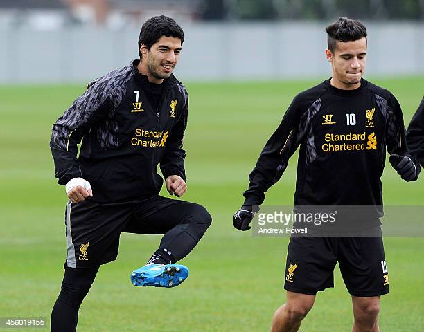 Luis Suarez and Philppe Coutinho of Liverpool in action during a training session at Melwood Training Ground on December 13 2013 in Liverpool England