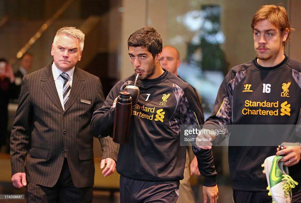 Luis Suarez (C) and Sebastian Coates of Liverpool FC walk to the team bus to attend training at the Grand Hyatt on July 22, 2013 in Melbourne, Australia.