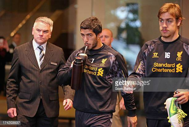 Luis Suarez and Sebastian Coates of Liverpool FC walk to the team bus to attend training at the Grand Hyatt on July 22, 2013 in Melbourne, Australia.