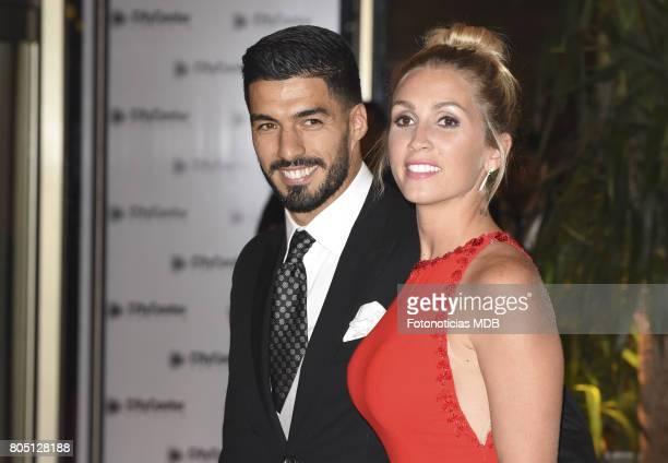 Luis Suarez and Sofia Balbi attend Lionel Messi and Antonela Rocccuzzo's wedding at the City Center Rosario Hotel Casino on June 30 2017 in Rosario...