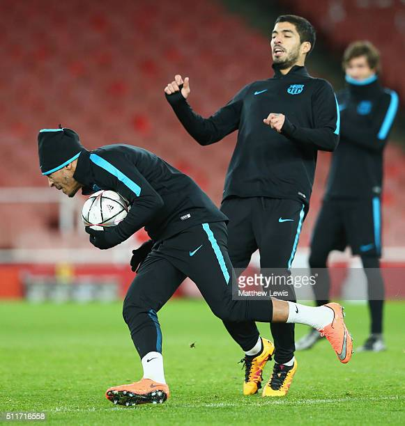 Luis Suarez and team mate Adriano perfomr a drill during a FC Barcelona training session ahead of their UEFA Champions League round of 16 first leg...