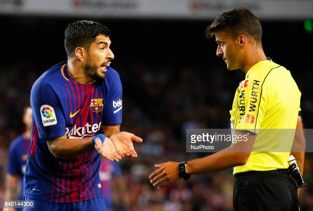 Luis Suarez and the referee Jesus Gil Manzano during La Liga match between FC Barcelona v RCD Espanyol in Barcelona on September 09 2017