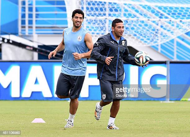 Luis Suarez and Walter Gargano of Uruguay during a training session at the Dunas Arena in Natal on June 23 2014 in Natal Brazil