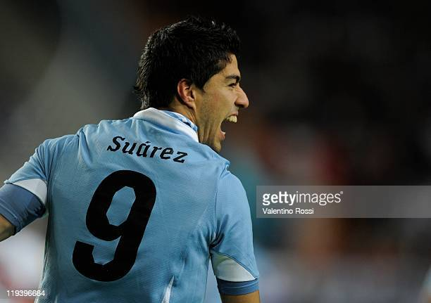 Luis Suarez celebrates after scoring against Peru during 2011 Copa America soccer match as part of semifinal at the Ciudad de La Plata stadium on...