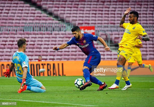 Luis Suarez Chichizola and David Simon during La Liga match between FC Barcelona v UD Las Palmas that has been played behind closed doors in...