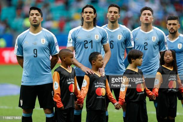 Luis Suarez Edinson Cavani and Rodrigo Bentancur of Uruguay sing the national anthem prior to the Copa America Brazil 2019 quarterfinal match between...
