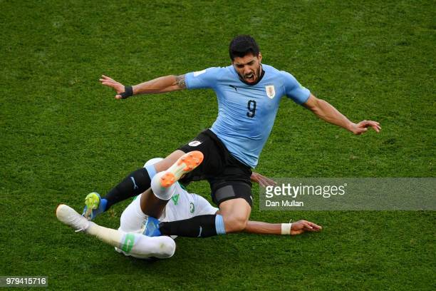 Luis Suarez i stackled by Ali Albulayhi of Saudi Arabia during the 2018 FIFA World Cup Russia group A match between Uruguay and Saudi Arabia at...