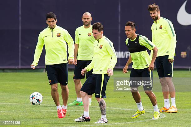 Luis Suarez Javier Mascherano Lionel Messi Adriano Correia and Gerard Pique in action during a training session ahead of their UEFA Champions League...
