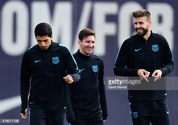 Luis Suarez Lionel Messi and Gerard Pique in discussion during a Barcelona training session ahead of their UEFA Champions League quarter final first...