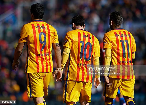 Luis Suarez Lionel Messi and Neymar JR of Barcelona walk on the pitch during the La Liga match between Levante UD and FC Barcelona at Ciutat de...