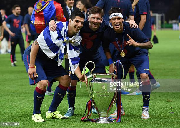 Luis Suarez, Lionel Messi and Neymar of Barcelona celebrate with the trophy after the UEFA Champions League Final between Juventus and FC Barcelona...