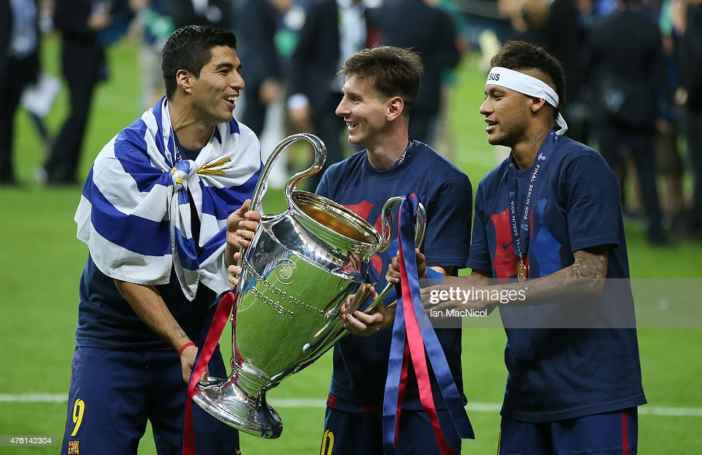 Luis Suarez, Lionel Messi and Neymar of Barcelona holds the trophy during the UEFA Champions League Final between Barcelona and Juventus at Olympiastadion on June 6, 2015 in Berlin, Germany.