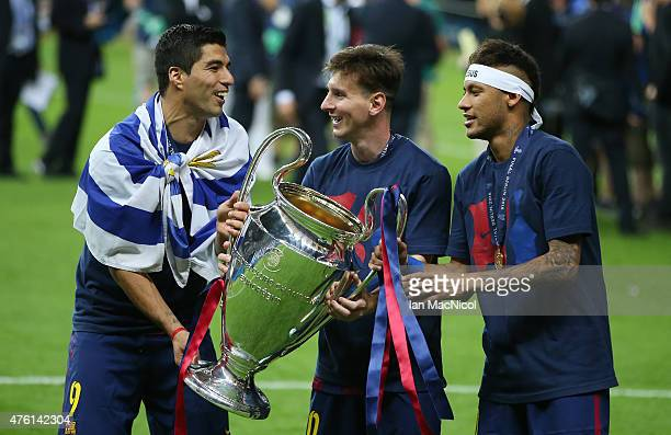 Luis Suarez Lionel Messi and Neymar of Barcelona holds the trophy during the UEFA Champions League Final between Barcelona and Juventus at...