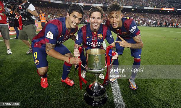 Luis Suarez Lionel Messi and Neymar of FC Barcelona pose with the Copa del Rey trophy after winning the Copa del Rey Final between Athletic Club and...