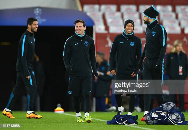 Luis Suarez Lionel Messi Neymar and Gerard Pique look on during a FC Barcelona training session ahead of their UEFA Champions League round of 16...