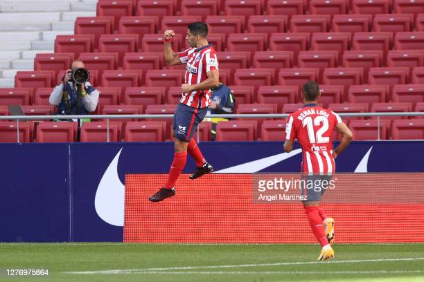 Luis Suarez of Atletico de Madrid celebrates after scoring his sides fifth goal during the La Liga Santander match between Atletico de Madrid and...