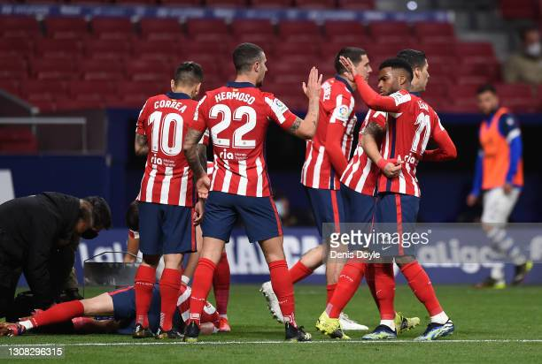 Luis Suarez of Atletico de Madrid celebrates with Angel Correa, Mario Hermoso and Thomas Lemar after scoring their side's first goal during the La...