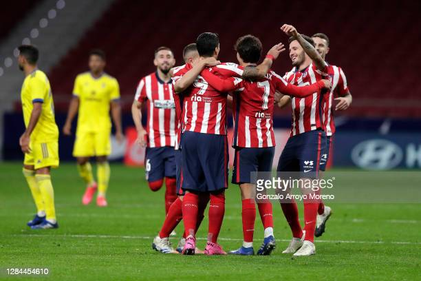 Luis Suarez of Atletico de Madrid celebrates with teammate Joao Felix after scoring his sides third goal during the La Liga Santander match between...