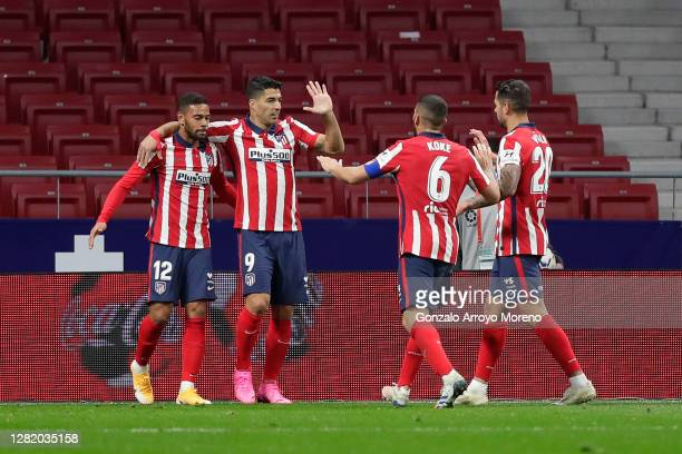 Luis Suarez of Atletico de Madrid celebrates with teammates after scoring his team's second goal during the La Liga Santander match between Atletico...