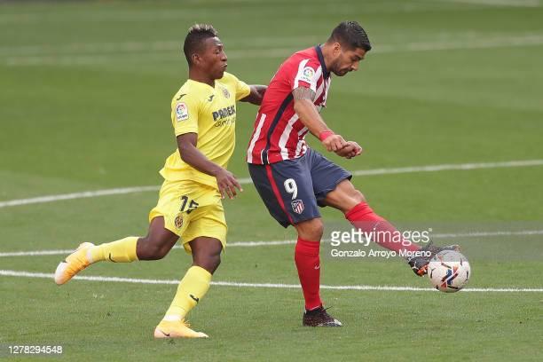 Luis Suarez of Atletico de Madrid competes for the ball with Pervis Estupinan of Villarreal CF during the La Liga Santader match between Atletico de...
