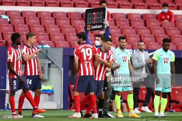 Luis Suarez of Atletico de Madrid replaces teammate Diego Costa during the La Liga Santander match between Atletico de Madrid and Granada CF at...