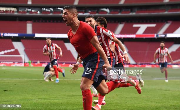 Luis Suarez of Atletico Madrid celebrates after scoring their team's second goal during the La Liga Santander match between Atletico de Madrid and...
