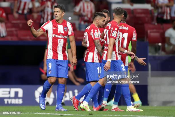 Luis Suarez of Atletico Madrid celebrates with teammates after scoring their team's first goal during the La Liga Santander match between Club...
