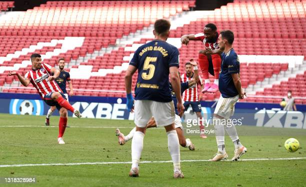 Luis Suarez of Atletico Madrid scores their team's second goal during the La Liga Santander match between Atletico de Madrid and C.A. Osasuna at...
