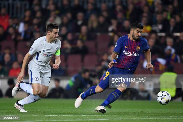 Luis Suarez of Barcelona and Cesar Azpilicueta of Chelsea compete for the ball during the UEFA Champions League Round of 16 Second Leg match FC...