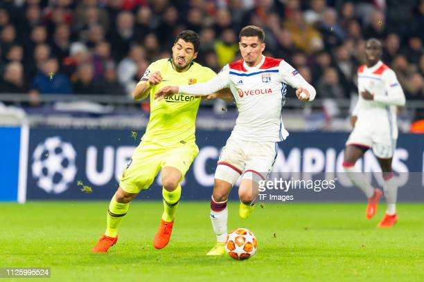 Luis Suarez of Barcelona and Houssem Aouar of Olympique Lyon battle for the ball during the UEFA Champions League Round of 16 First Leg match between...