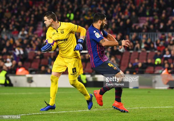Luis Suarez of Barcelona and Ivan Cuellar of Leganes collide during the La Liga match between FC Barcelona and CD Leganes at Camp Nou on January 20...