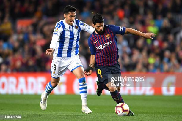Luis Suarez of Barcelona and Mikel Merino of Real Sociedad clash during the La Liga match between FC Barcelona and Real Sociedad at Camp Nou on April...
