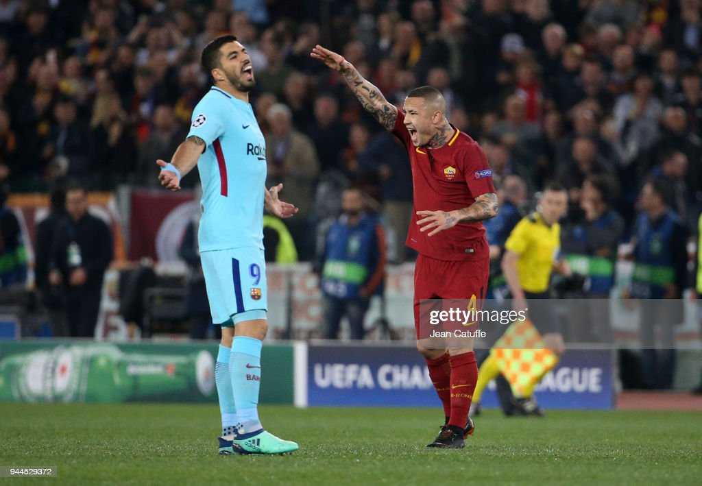 Luis Suarez of Barcelona and Radja Nainggolan of AS Roma react differently following the first goal of Edin Dzeko of AS Roma during the UEFA Champions League Quarter Final second leg match between AS Roma and FC Barcelona (Barca) at Stadio Olimpico on April 10, 2018 in Rome, Italy.