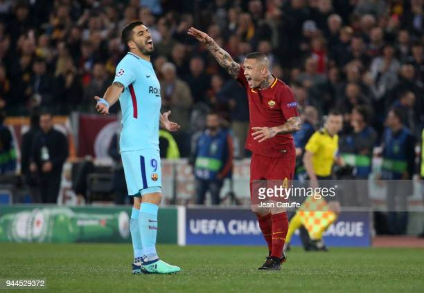 Luis Suarez of Barcelona and Radja Nainggolan of AS Roma react differently following the first goal of Edin Dzeko of AS Roma during the UEFA...