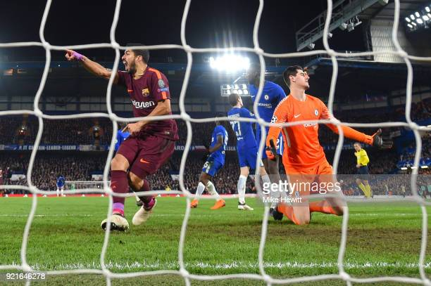 Luis Suarez of Barcelona celebrates after Lionel Messi of Barcelona scores his sides first goal as Thibaut Courtois of Chelsea looks dejected during...