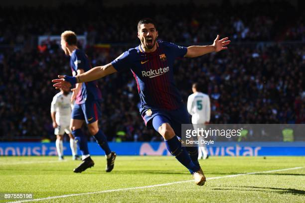 Luis Suarez of Barcelona celebrates after scoring his sides first goal during the La Liga match between Real Madrid and Barcelona at Estadio Santiago...