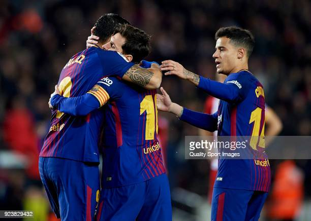 Luis Suarez of Barcelona celebrates after scoring his sides first goal with his teammates Lionel Messi and Philippe Coutinho during the La Liga match...