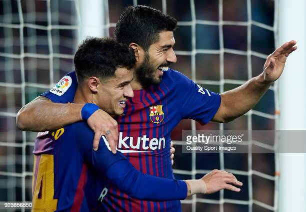 Luis Suarez of Barcelona celebrates after scoring his sides fourth goal with his teammate Philippe Coutinho during the La Liga match between...