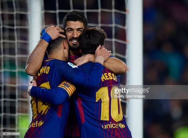 Luis Suarez of Barcelona celebrates after scoring his sides fourth goal with his teammates Philippe Coutinho and Lionel Messi during the La Liga...