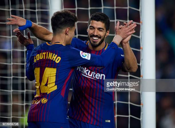 Luis Suarez of Barcelona celebrates after scoring his sides fourth goal with his teammates Philippe Coutinho during the La Liga match between...