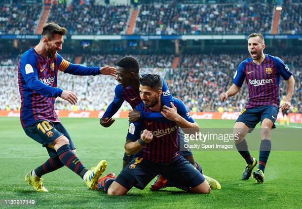 Luis Suarez of Barcelona celebrates after scoring his team's first goal with his teammates Lionel Messi, Ousmane Dembele and Jordi Alba during the...