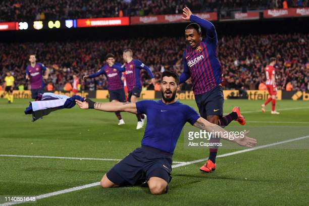 Luis Suarez of Barcelona celebrates after scoring his team's first goal with Malcom during the La Liga match between FC Barcelona and Club Atletico...