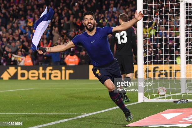 Luis Suarez of Barcelona celebrates after scoring his team's first goal during the La Liga match between FC Barcelona and Club Atletico de Madrid at...