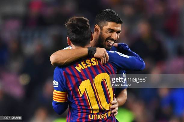 Luis Suarez of Barcelona celebrates after scoring his team's second goal with Lionel Messi during the La Liga match between FC Barcelona and CD...