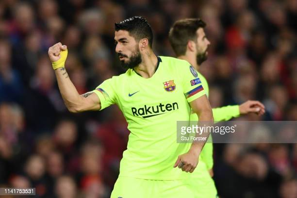 Luis Suarez of Barcelona celebrates as a Luke Shaw own goal gives his side the lead during the UEFA Champions League Quarter Final first leg match...