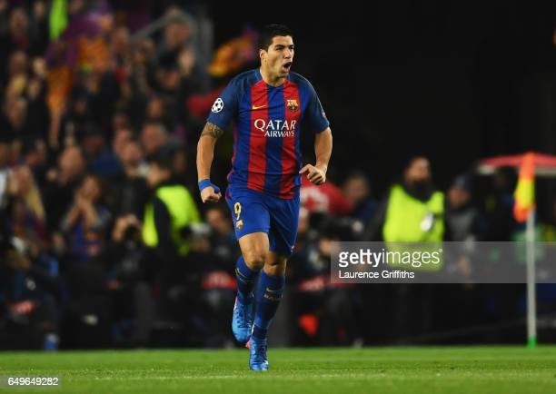 Luis Suarez of Barcelona celebrates as he scores their first goal during the UEFA Champions League Round of 16 second leg match between FC Barcelona...