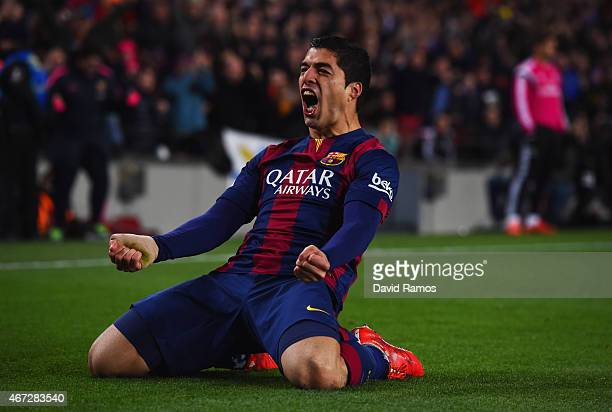 Luis Suarez of Barcelona celebrates as he scores their second goal during the La Liga match between FC Barcelona and Real Madrid CF at Camp Nou on...