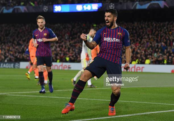 Luis Suarez of Barcelona celebrates as Philippe Coutinho scores his team's second goal during the UEFA Champions League Round of 16 Second Leg match...
